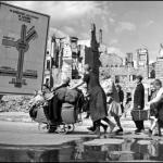 Berlin. 1945.Refugees making their way through the ruined Soviet sector. Robert Capa © International Center of Photography