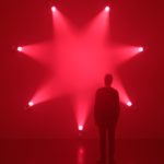 Rose. Ann Veronica Janssens. 7 light projectors, artificial haze, pink filters 2007