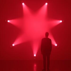 Rose. Ann Veronica Janssens. 7 light projectors, artificial haze, pink filters 2007